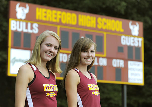Hereford juniors Sara Carter, left, and Erin Causey are a big reason for the Bulls' recent success in cross country.