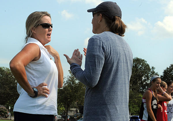 Severna Park field hockey coach Ann Andrews, left, talks with Falcons goalie coach Carey Borkoski during a recent practice. Andrews replaces the legendary Lil Shelton as coach at Severna Park this season.