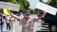 Demonstrators on Saturday gathered in front of the Costa Mesa Police Department to support Mayor Pro Tem Jim Righeimer, who they contend was falsely accused of driving drunk by a private investigator who works for a law firm that represents police unions.