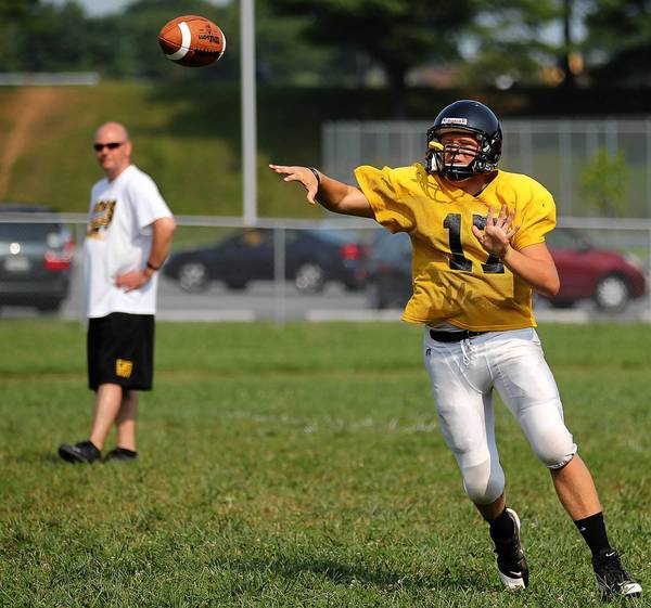 Senior Kyle MacIvor throws the ball during practice at South Carroll High School in on Aug. 17. MacIvor had 13 completions for 133 yeard in 2011, but the Cavaliers are expected to throw more in 2012 in an attempt to loosen the ground game.