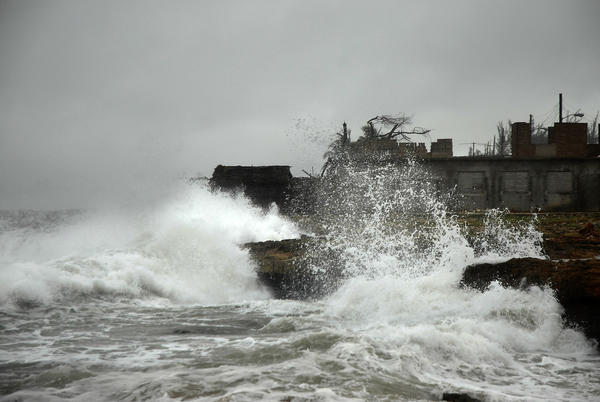 Waves lash the shore of Cuba's Gibara, in Holguin province, as Tropical Storm Isaac approached.