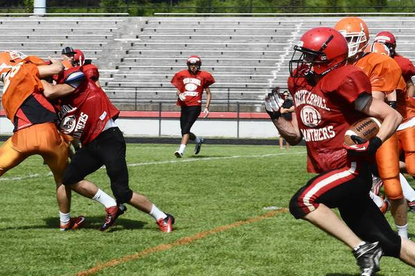 Key blocks open up a hole for North Carroll's Sean Floto as he carries for a run in an Aug. 18 scrimmage against Fallston. Floto will pull duty as a key Panther linebacker for the 2012 campaign.