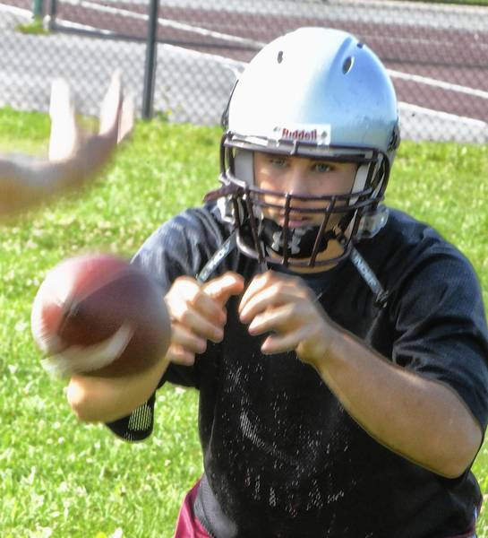 Winters Mill junior quarterback Cole Myers runs through a passing drill during practice. Meyers may split duties under center this year with Falcons senior Wes Cook.