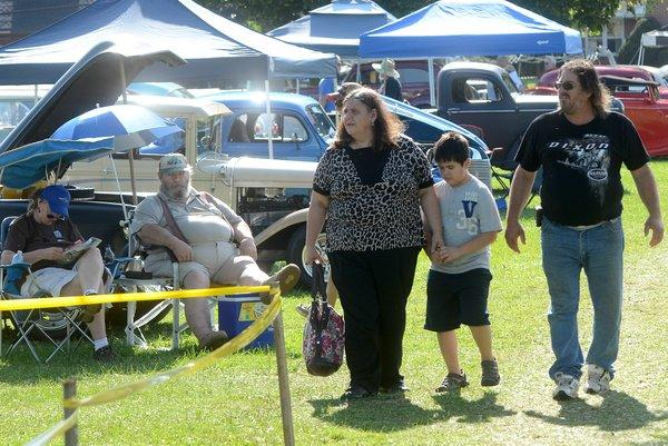 Cecelia and Dana Brumbach of Boyertown stroll through the annual Wheels of Time Rod & Custom Jamboree at Macungie Memorial Park with son Nathan, 8, on Sunday.