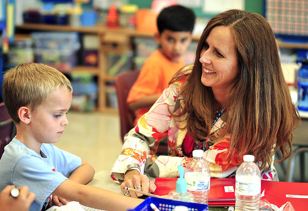 Christina Hammer-Atkins helps Joey Breeden with his classwork Friday at Boonsboro Elementary School. Christina Hammer-Atkins is Washington County Teacher of the Year and is also a state finalist for 2012-13 Maryland Teacher of the Year.