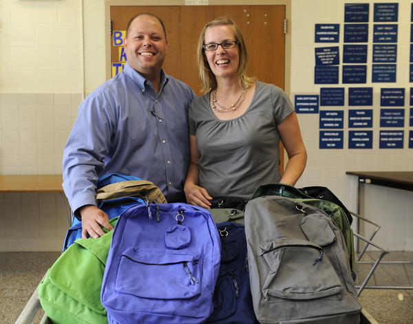 Dan and Heather Simons deliver backpacks filled with school supplies to Halethorpe Elementary School.