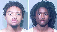 Murder and armed robbery charges have been filed against two men accused of gunning down and robbing a man sitting in a car with his girlfriend in the Bronzeville neighborhood early Saturday, police said.