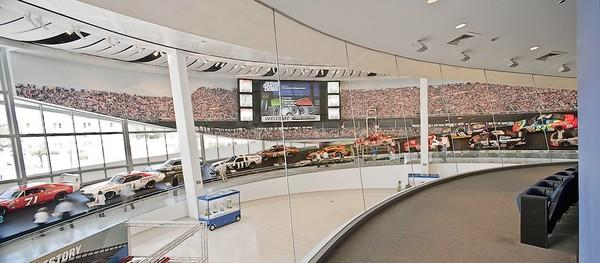 "The NASCAR Hall of Fame's ""Glory Road"" displays cars from the different eras of stock car racing."