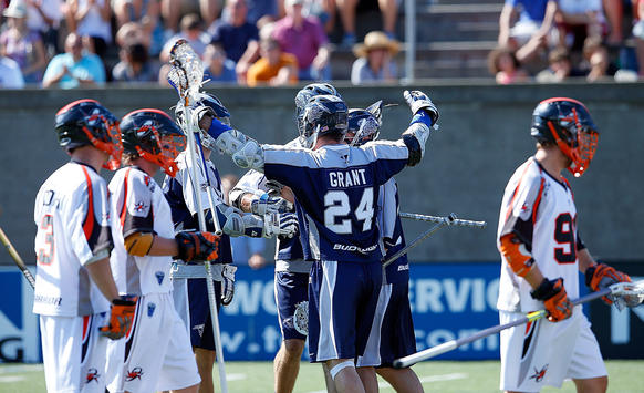 John Grant Jr. of the Chesapeake Bayhawks celebrates with his teammates after a first-quarter goal.
