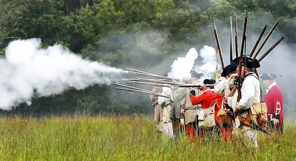 Soldiers fire their muskets Sunday during a re-enactment of a battle of the French and Indian War at Fort Frederick State Park.