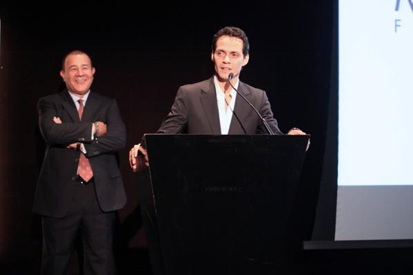 Singer Marc Anthony (right) and entrepreneur Henry Cardenas (left) address guests at the Maestro Cares Foundation fundraiser at Sofitel Chicago Water Tower August 20, 2012.