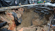 Heavy rains cause Monument Street sinkhole to reopen, widen