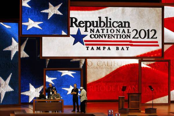 Workers prepare the stage for the Republican National Convention in Tampa, Fla. Organizers said the convention would proceed as scheduled beginning Tuesday, after a delay prompted by Tropical Storm Isaac.