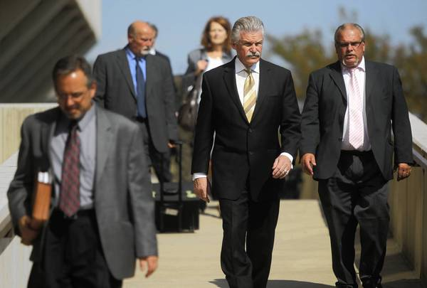 Will County State's Attorney James Glasgow, center, and the prosecution team leave the Will County Courthouse in Joliet after arguments in the Drew Peterson murder trial on Friday.