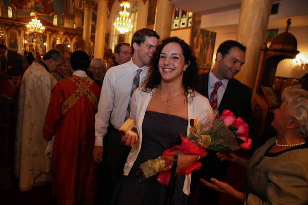 Christina Loukas, a diver from Riverwoods who participated in the Summer Olympics, leaves Annunciation Greek Orthodox Cathedral on Sunday. Loukas received the Medal of Saint Paul, the highest honor the Greek Orthodox Archdiocese of America bestows on a layperson.