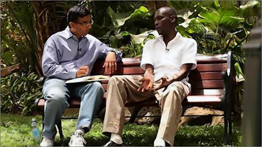 Co-director Dinesh D'Souza, left, interviews George Obama in Nairobi, Kenya.