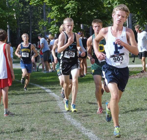 Logan Hensley of Petoskey runs Saturday in the Pete Moss Cross Country Invitational at Benzie Central.