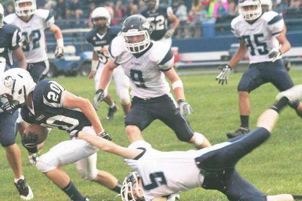 Petoskey's David Grindell (5) grabs hold of Michael James of Sault Ste. Marie as James returns a kickoff Friday at A.J. VanCitters Field in Sault Ste. Marie.