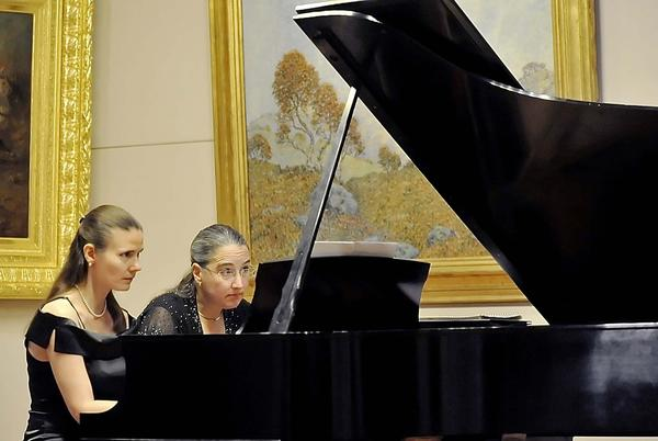"Alice Fiedlerova, left, and Joan DeVee Dixon play the piano Sunday during ""One Piano, Four Hands"" at Washington County Museum of Fine Arts. The recital was sponsored in part by Mr. and Mrs. John F. Barr of Clear Spring. Dixon and Fiedlerova are featured artists for the International Dvorak Society¿s American Spring Festival in the Czech Republic. They have also performed in the United States for concerts sponsored by the Czech Consolate in Chicago and the Embassy of the Czech Republic in Washington, D.C. A reception hosted by the Frostburg State University Alumni Association and the Singer Society, the museum's volunteer organization, followed the recital."