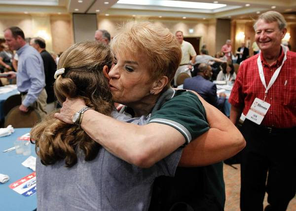 Illinois State Comptroller Judy Baar Topinka greets friends during the state GOP delegation breakfast on Monday at the Sheraton Sand Key Resort in Clearwater Beach, Fla. Hurricane Isaac will delay the kickoff of the RNC at the Tampa Bay Times Forum until Tuesday