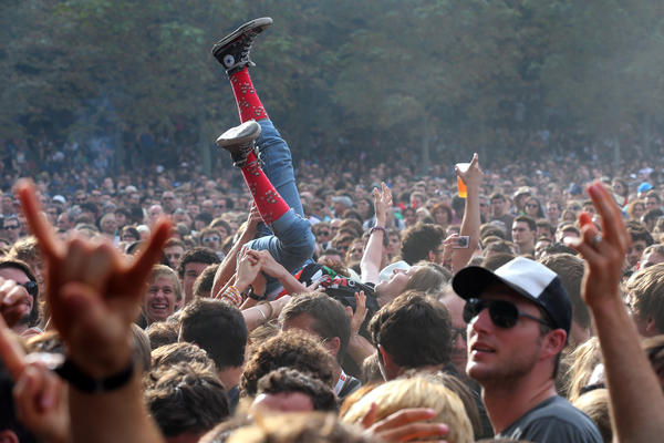 People attend a concert of US Punk Rock band Social Distortion during the Rock-en-Seine music festival on August 26, 2012, in Saint-Cloud, near Paris.