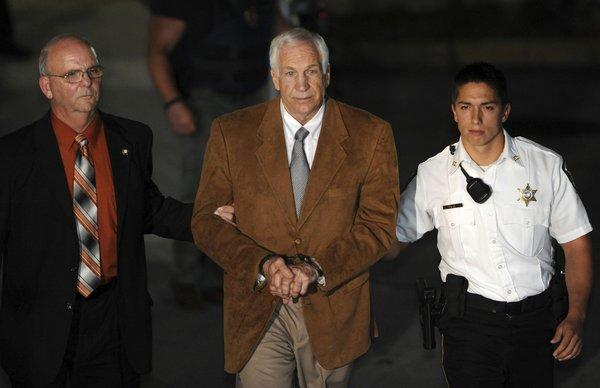 Jerry Sandusky is taken from the courthouse in handcuffs to jail to await sentencing.