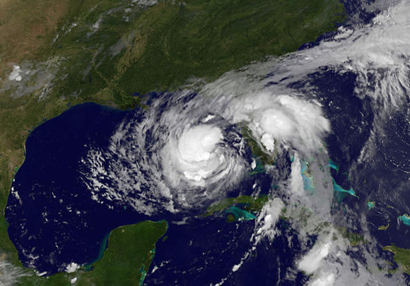 This satellite image released by NOAA shows Tropical Storm Isaac as it takes aim at Louisiana and other Gulf states Monday. (NOAA / AFP/Getty Images / August 27, 2012)