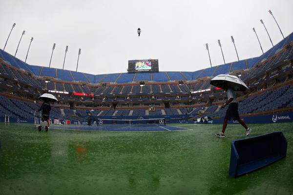 Rain interrupts play during Day 1 of the U.S. Open.