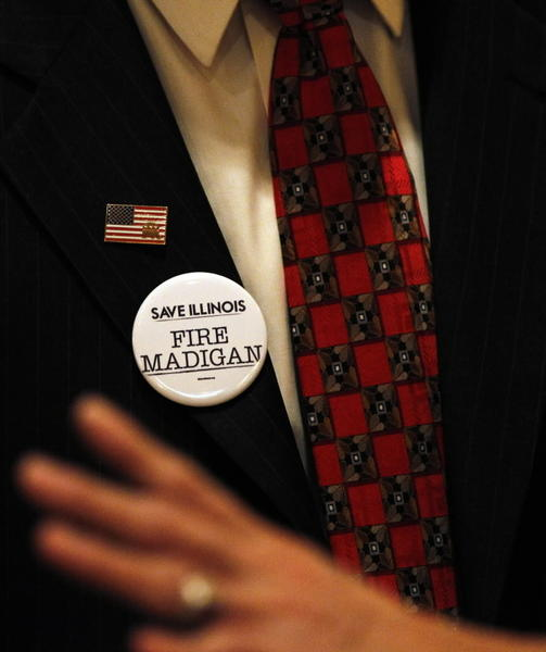 "Illinois Republican Chairman Pat Brady wears a ""Fire Madigan"" button at Monday's state party convention delegation breakfast."