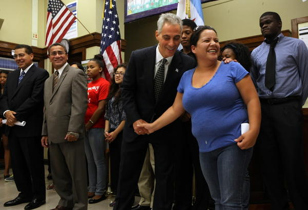 Mayor Rahm Emanuel shakes hands with Wells High School parent Irais Barajas as he announces a CTA fare card program Monday.