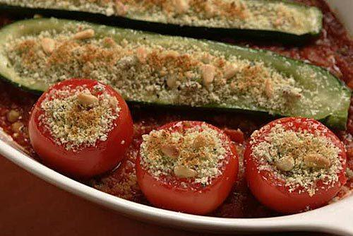 Garlic and herb-stuffed tomatoes and zucchini.