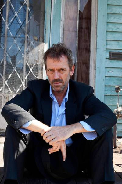 Hugh Laurie plays with the Copper Bottom Band Saturday at the Rhythm & Roots Festival in Charleston R.I.