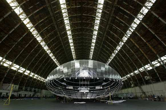 A new blimp-like airship is being constructed by Worldwide Aeros in a World War II-era blimp hanger at a former military base in Tustin. The airship will be used by the military to carry tons of cargo to remote areas around the world.