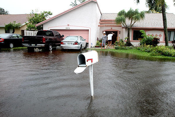 Flood waters on NW 52 street in Lauderhill approached the garages of several homes during Tropical Storm Isaac on Monday, August 27, 2012.
