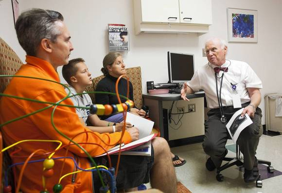 Dr. Ira  DuBrow, right, a pediatric cardiologist at Advocate Lutheran General Children's Hospital in Park Ridge, discusses test results with Owen Kopka, 11,and his parents, Wendy and Steve Kopka. DuBrow believes that doctors should be ombudsmen for their patients and their pocketbooks.