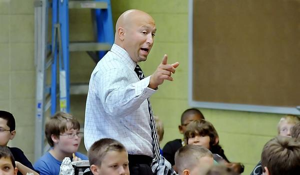 Waynesboro Area Middle School Principal Aaron Taylor talks to students in the cafeteria Monday during lunch on the first day of school.
