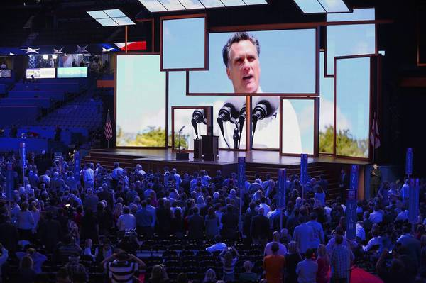 Republican presidential candidate Mitt Romney is shown on a bank of video monitors on the opening day of the Republican National Convention on Monday, August 27, 2012, at the Tampa Bay Times Forum in Tampa, Fla.