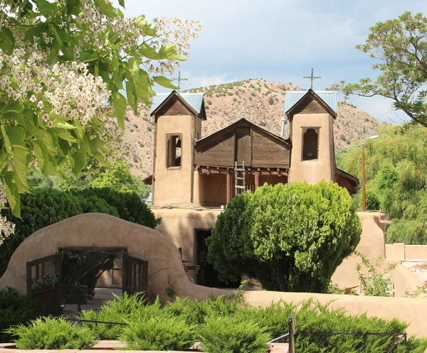 "El Santuario de Chimayo, located in northern New Mexico about 20 miles north of Santa Fe, is Roman Catholic church and an important pilgrimage site. Sometimes called the ""Lourdes of America,"" it attracts about 300,000 visitors yearly. Reader ""RPVCitizen"" photographed the shrine during a 6,600-mile summer road trip."
