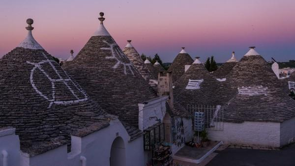 In June, Adam Allegro visited Alberobello, an Italian town known for its trulli, cone-shaped dwellings made from limestone without the use of mortar. UNESCO recognized the trulli of Alberobello as a World Heritage site in 1996.