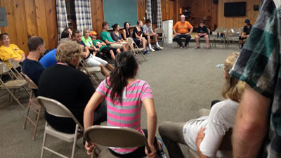 Community members meet Monday night at Perry Hall Presbyterian Church to discuss the shooting at Perry Hall High School.
