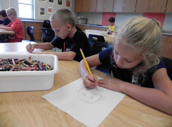 Second-graders Cole Smith, left, and Skylar Pittman draw self-portraits Monday in the new art room at Mercersburg (Pa.) Elementary School on the first day of school.
