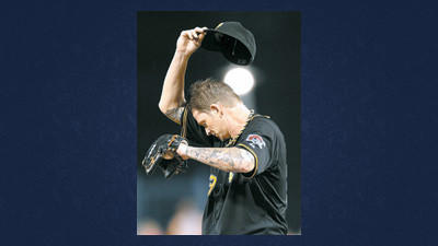 Pittsburgh Pirates starting pitcher A.J. Burnett wipes his head after walking St. Louis Cardinals' Matt Carpenter in the fourth inning of the baseball game on Monday in Pittsburgh.