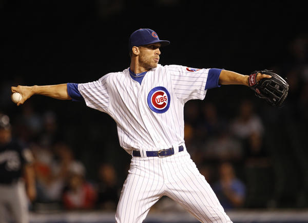 Outfielder Joe Mather took a turn on the mound during a rough ninth inning for the Cubs.