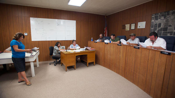 Seeley resident Aloma Harris (left) reads a letter Monday at a Seeley County Water District board meeting alleging minutes of an SCWD earlier this summer were altered, resulting in an increase in water rates for the Seeley Community Church.