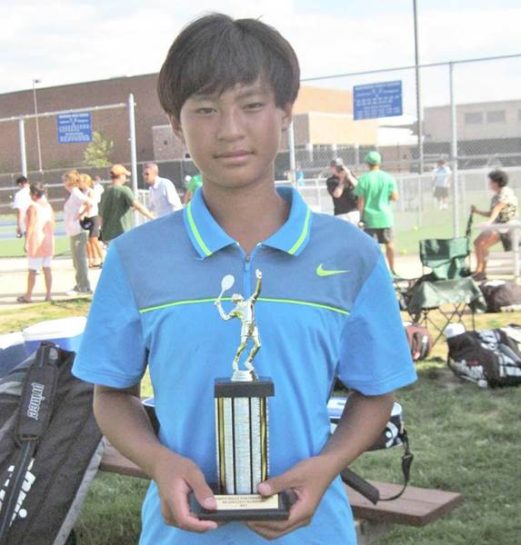 Petoskey freshman Nico Ceniza displays the trophy he earned Monday by winning the No. 4 singles flight Monday at the Grand Rapids Forest Hills Northern Quad. Ceniza is 12-1 on the season.