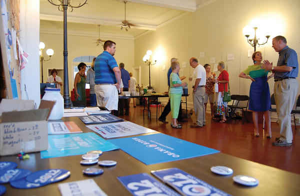 Franklin County, Pa., Democrats socialize Monday at the opening of their Waynesboro, Pa., office at 4 E. Main St. The office will be open through the Nov. 6 general election and joins one on South Main Street in Chambersburg, Pa. County Republicans have an office in Chambersburg's Southgate Shopping Center.