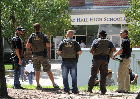 U.S. Marshalls and other special units guard Perry Hall High School after a student was shot by another student on the first day of school.