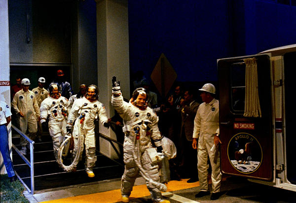 Beginning the Mission The Apollo 11 crew leaves Kennedy Space Center's Manned Spacecraft Operations Building during the pre-launch countdown. Mission commander Neil Armstrong, command module pilot Michael Collins, and lunar module pilot Buzz Aldrin prepare to ride the special transport van to Launch Complex 39A where their spacecraft awaited them. Liftoff occurred at 9:32 a.m. EDT, July 16, 1969.