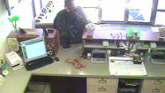 "Greenwood police are looking for a ""soft spoken"" man who disguised himself while robbing a bank."