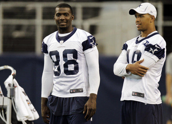Dallas Cowboys wide receiver Dez Bryant, left, talks with teammate Miles Austin during practice.